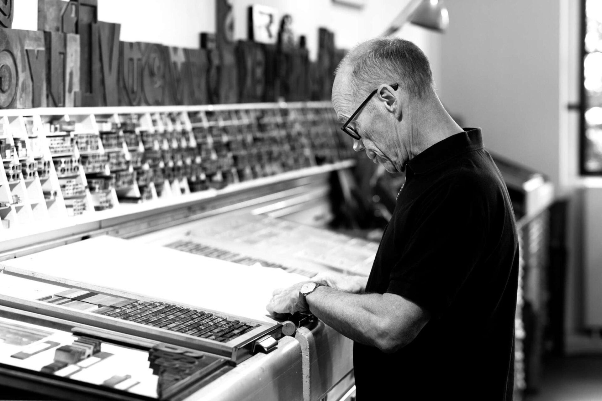 Erik Spiekermann is setting type by hand.